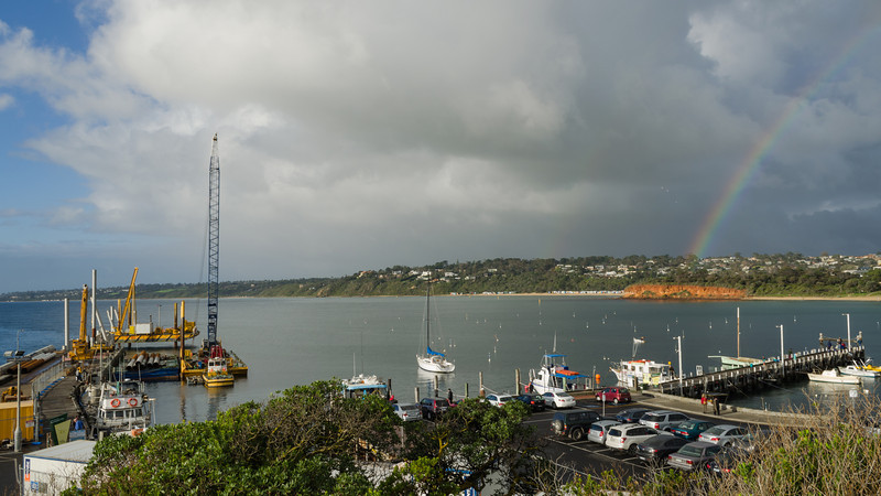 Not too many yachts in the water over winter, but there's storm clouds and a rainbow over the Mornington Marina on this day.