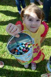Karla showing off the rewards of her Easter Egg hunt