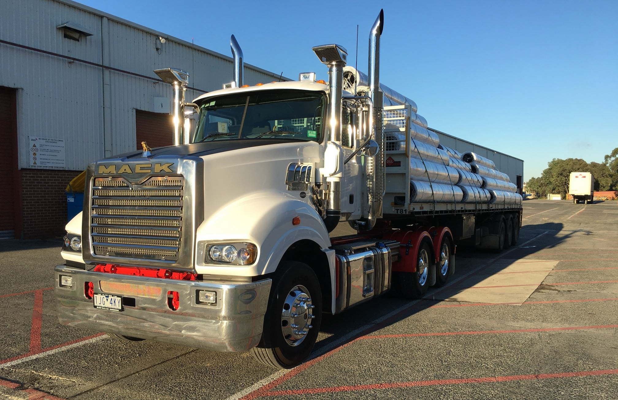 Mack Superliner with a load of roller-doors
